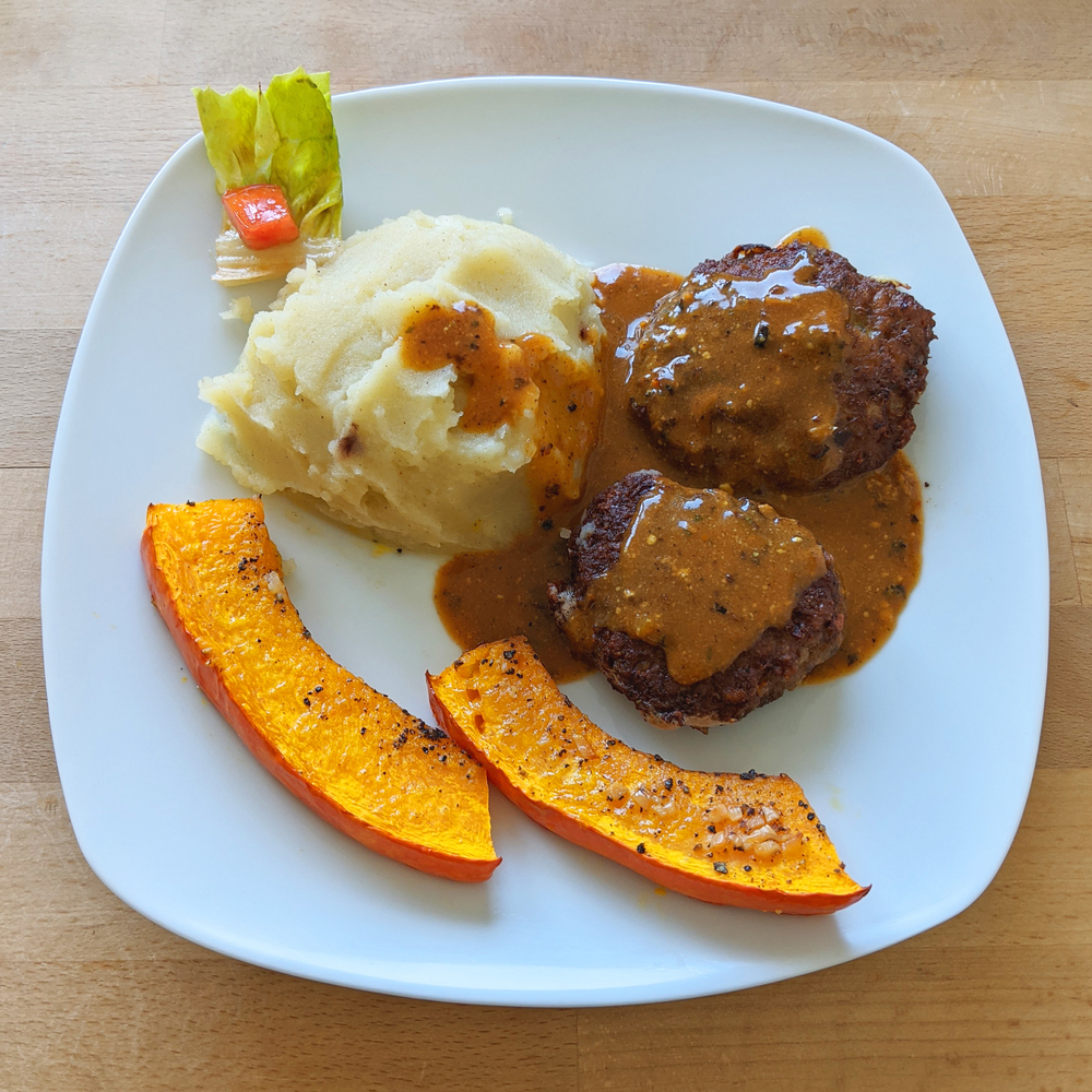 Meat patties with mashed potatoes and pumpkin slices from the oven